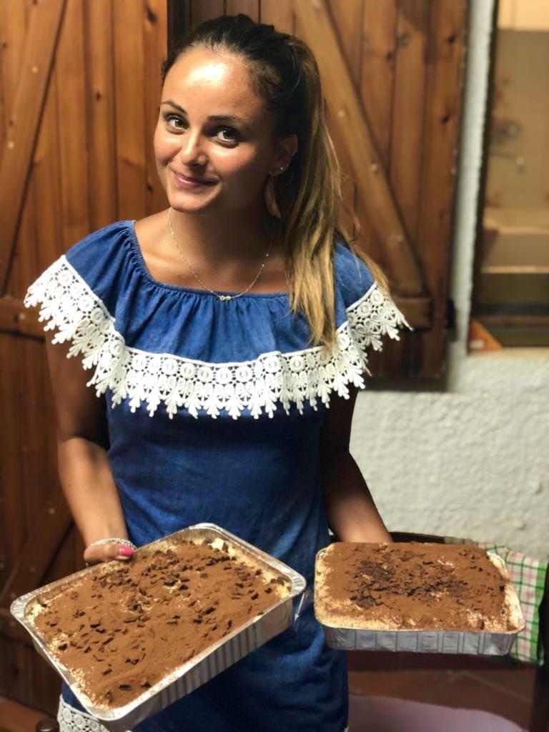 woman holding platters of tiramisu in