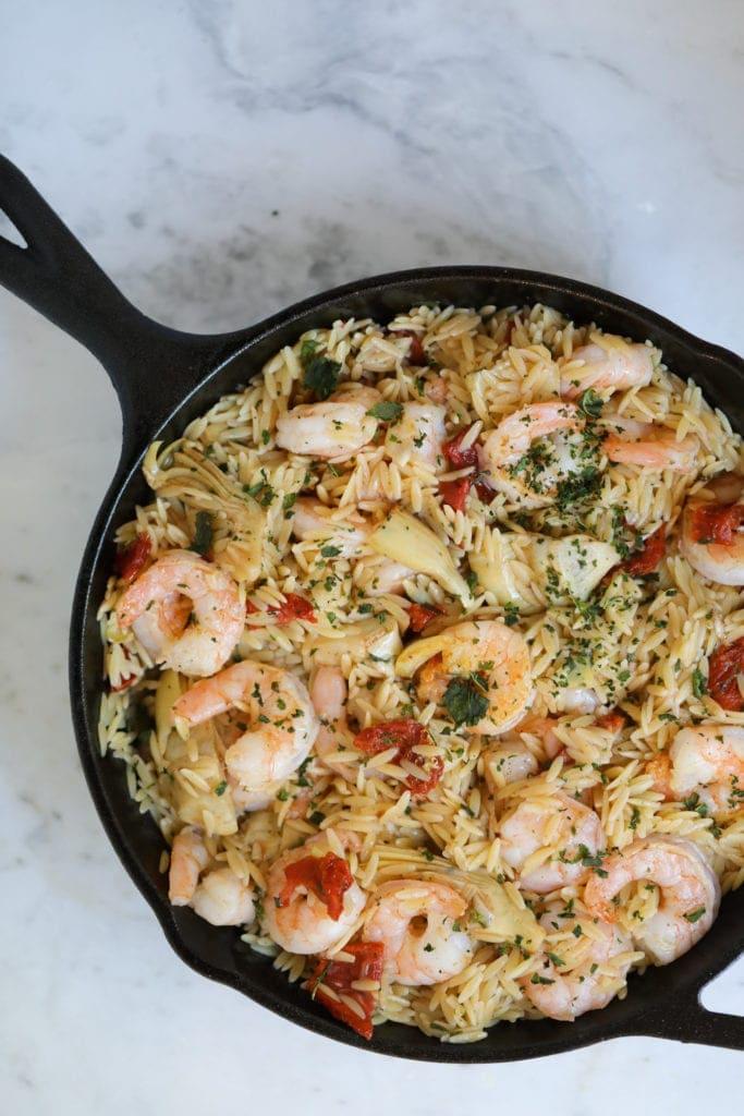 Orzo pasta, shrimp pasta, sun-dried tomatoes and artichokes, Italian recipe