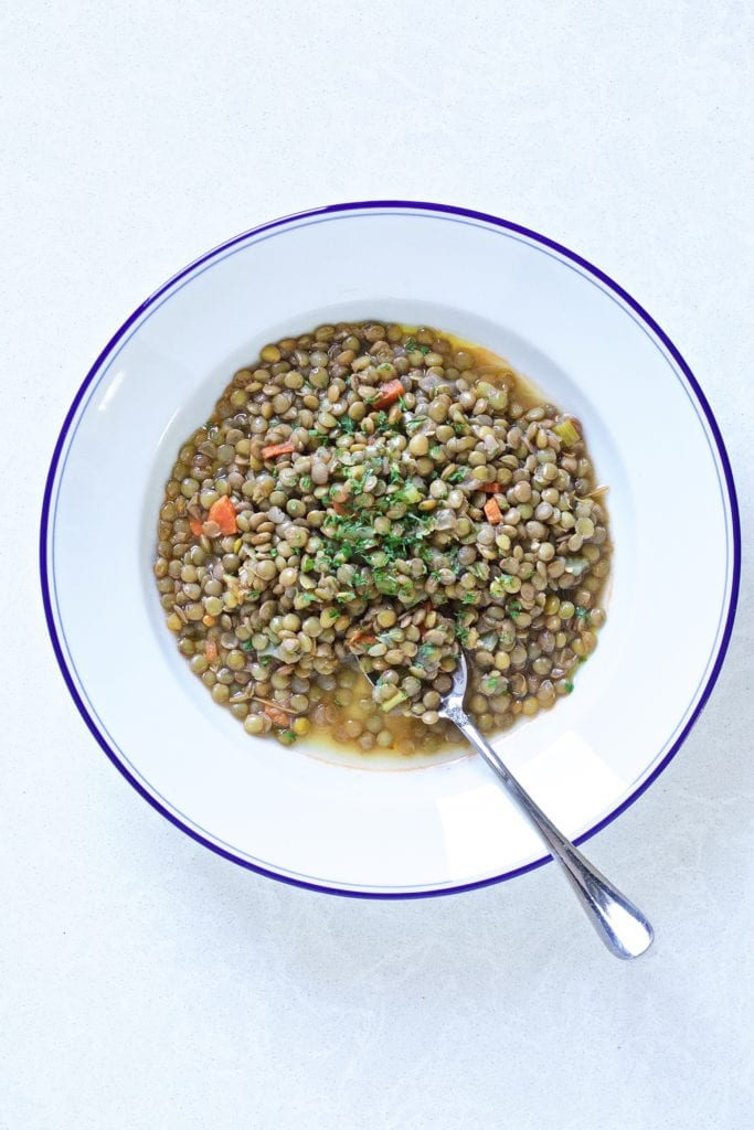 lentils on a plate with bread