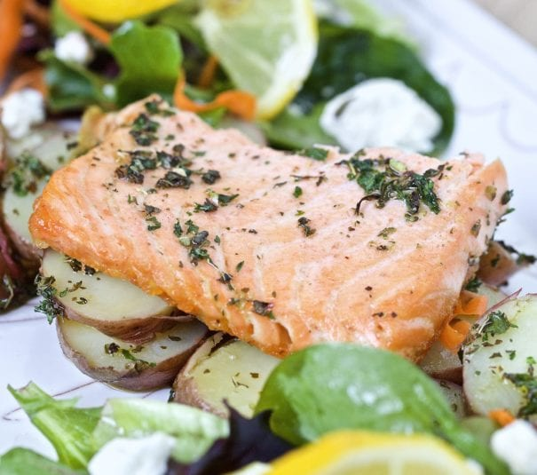 salmon salad with potatoes on a platter