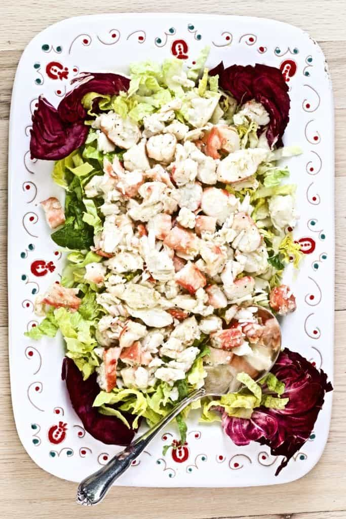 platted final dish with crab and salad on a large platter