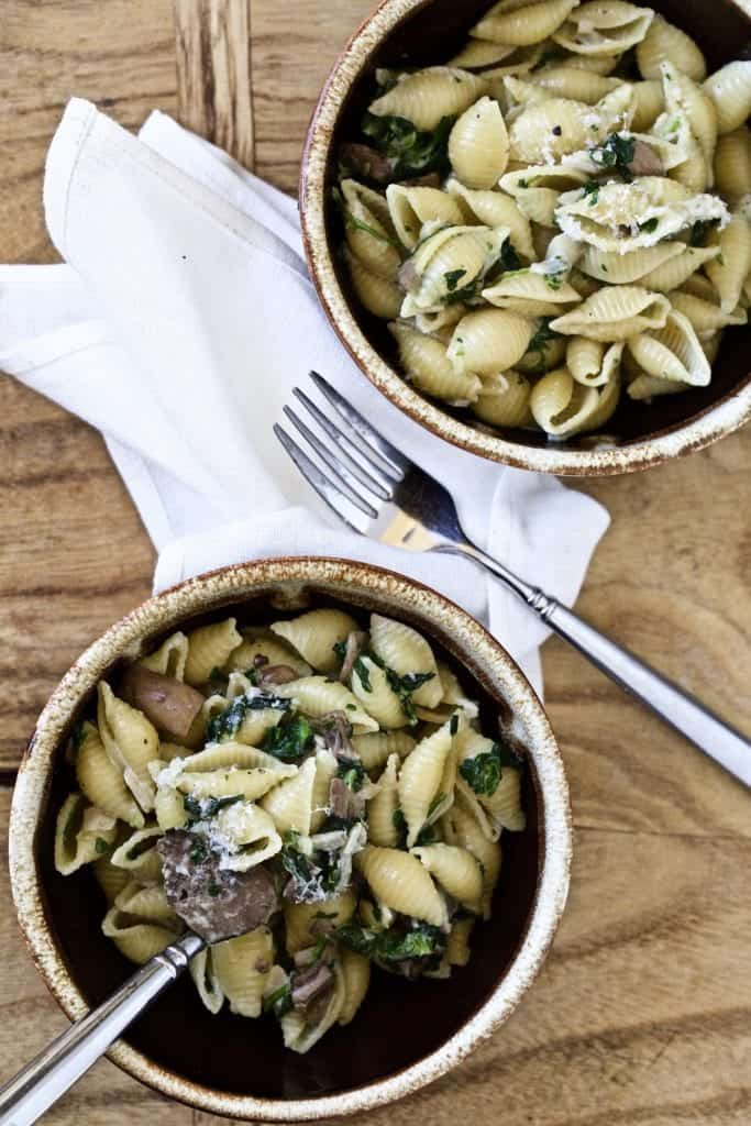 plate of creamy mushroom and spinach pasta shells on serving platter