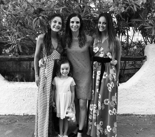 Sardegna home. Three women and one girl standing in a street in Italy, black and white photo