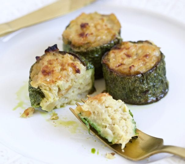 stuffed zucchini on a plate with a fork