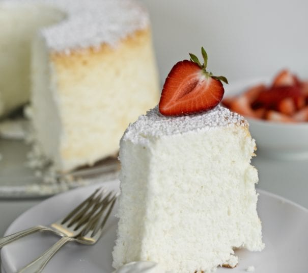 angel food cake on a plate with strawberries