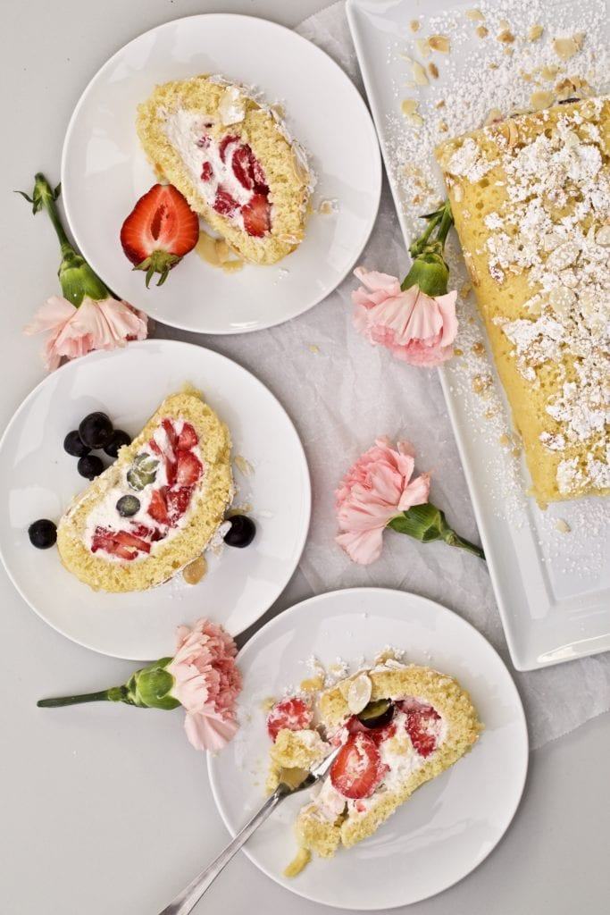 Vanilla Cake Roll with Berries slices on a several plates