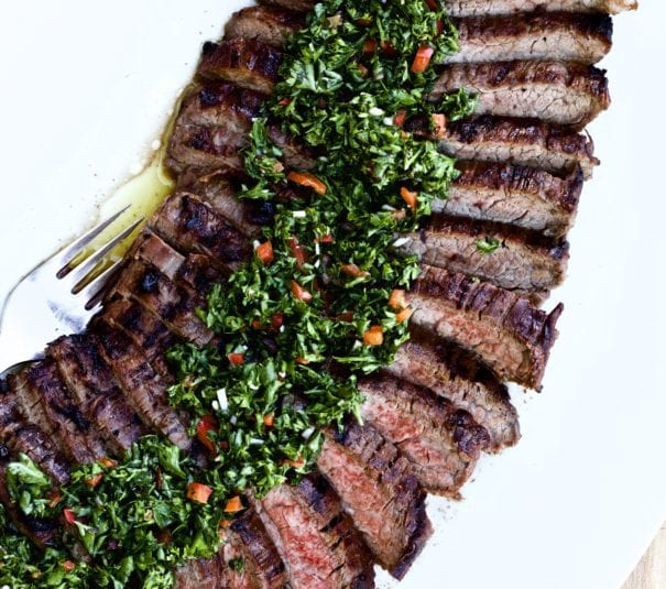 Tri-tip steak and chimichurri sauce on a plate