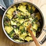 Ravioli Piccata mushrooms and asparagus in a skillet pan