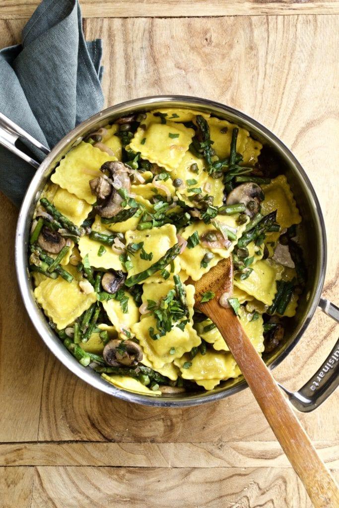 Ravioli mushrooms and asparagus in a skillet pan