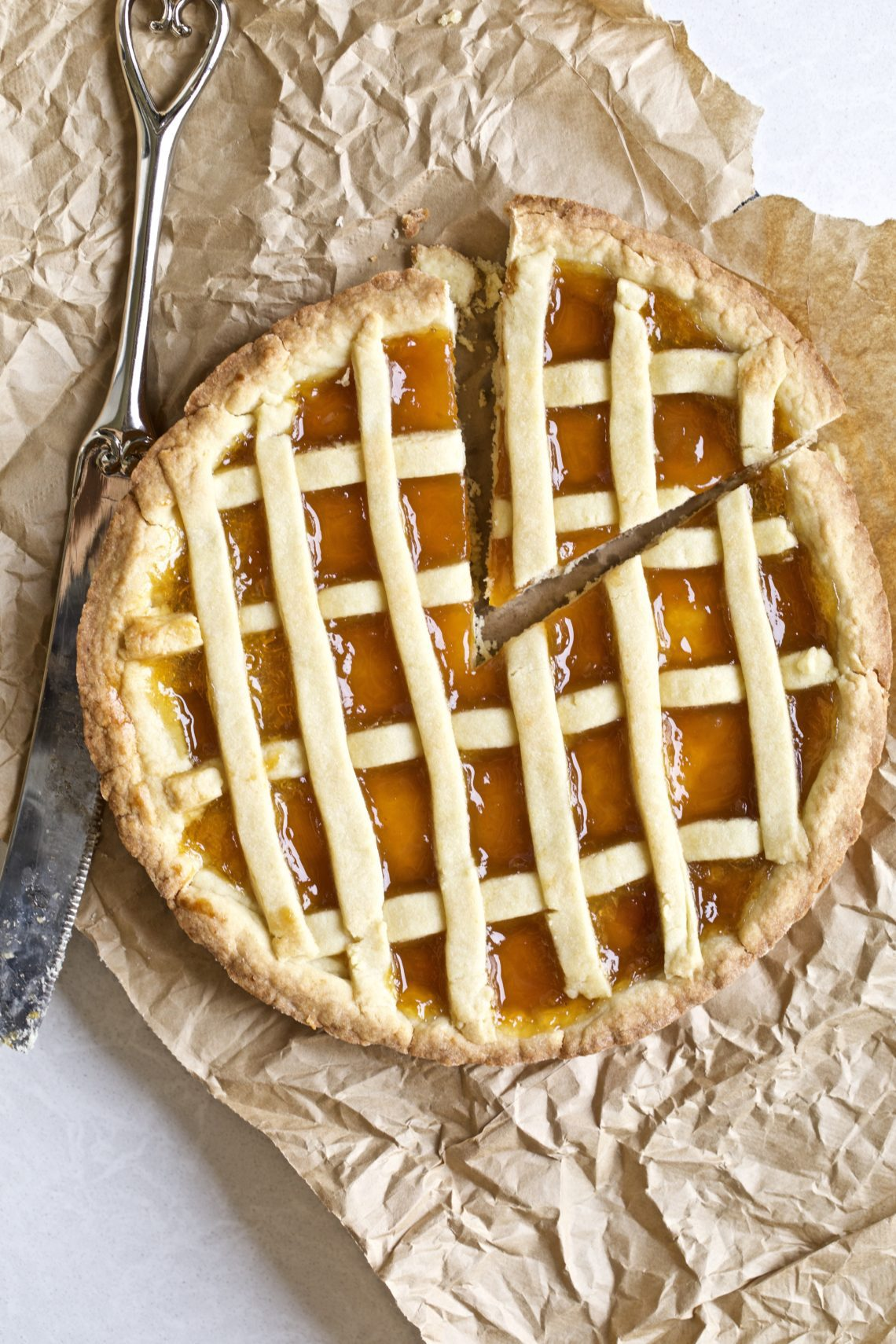 Whole crostata with a slice taken out