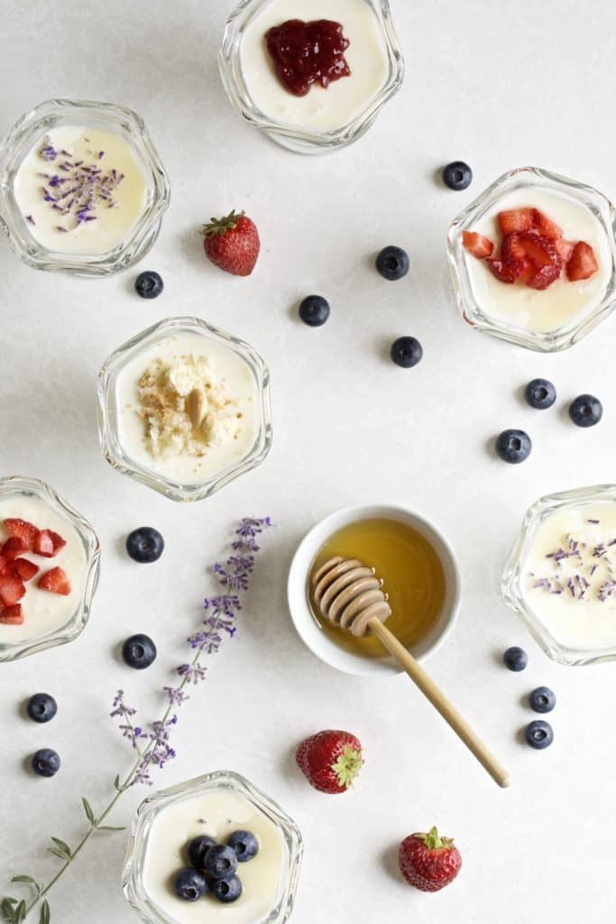 panna cotta with different toppings in little glass bowls