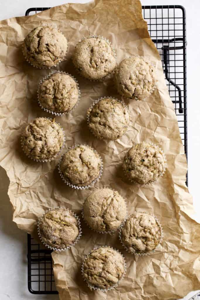 cinnamon zucchini muffins on a cooling rack