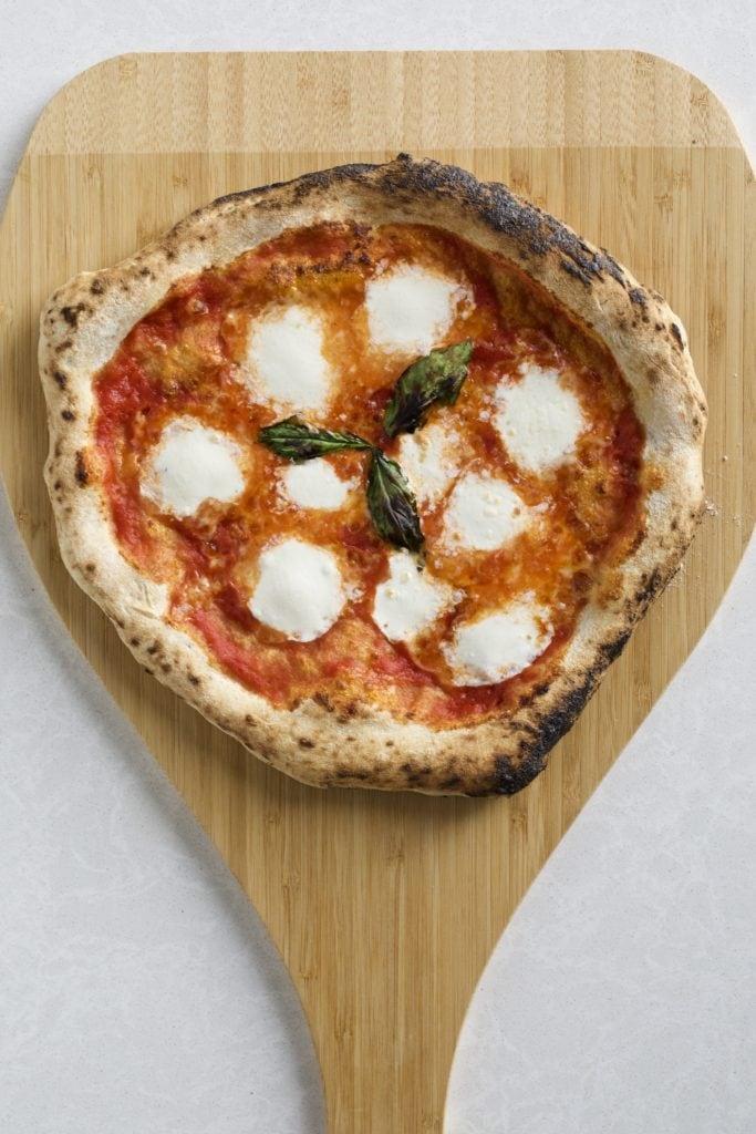 pizza napoletana on a wood board