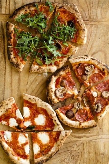 pizza napoletana (Neapolitan) on a wood board