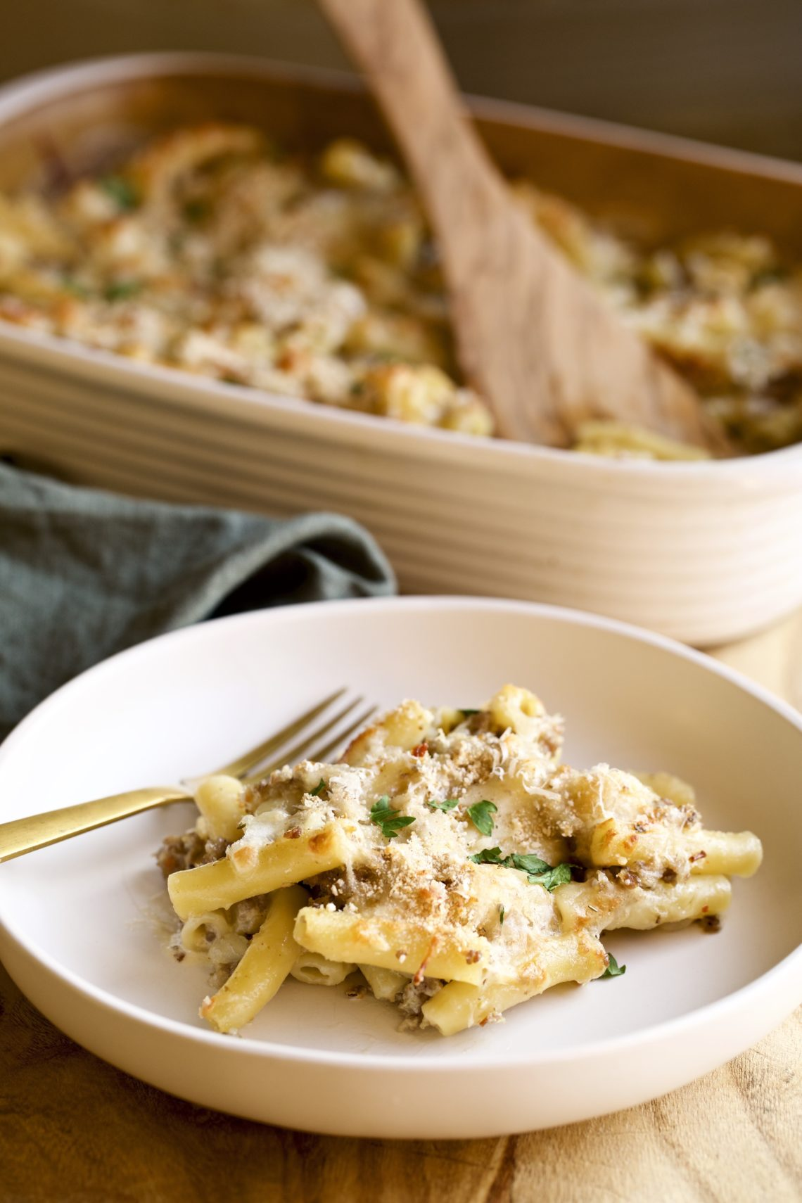 creamy sausage baked ziti on a plate with a fork